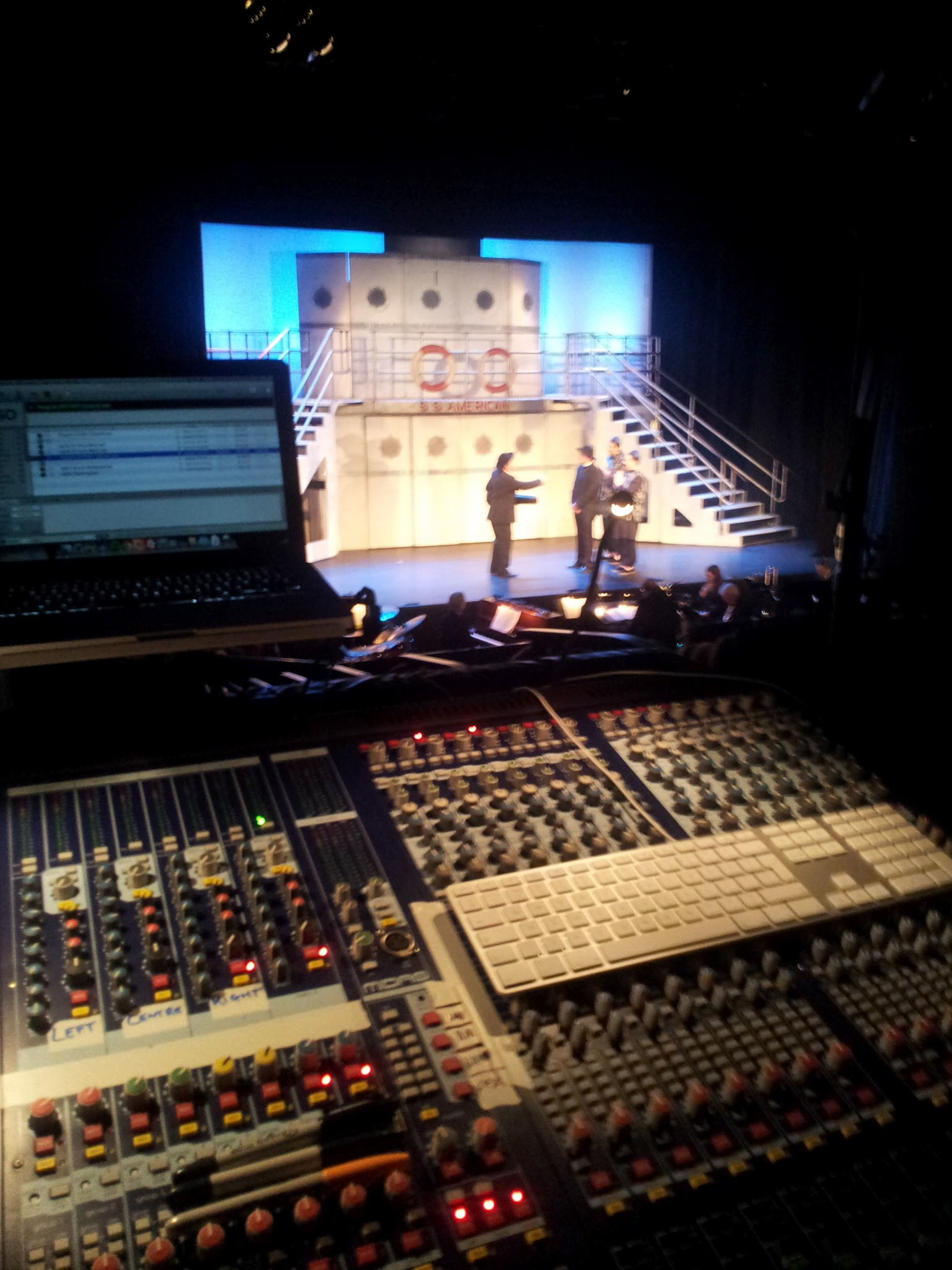 Midas Verona 400 and Qlab playback with the stage in the background in theatre lights