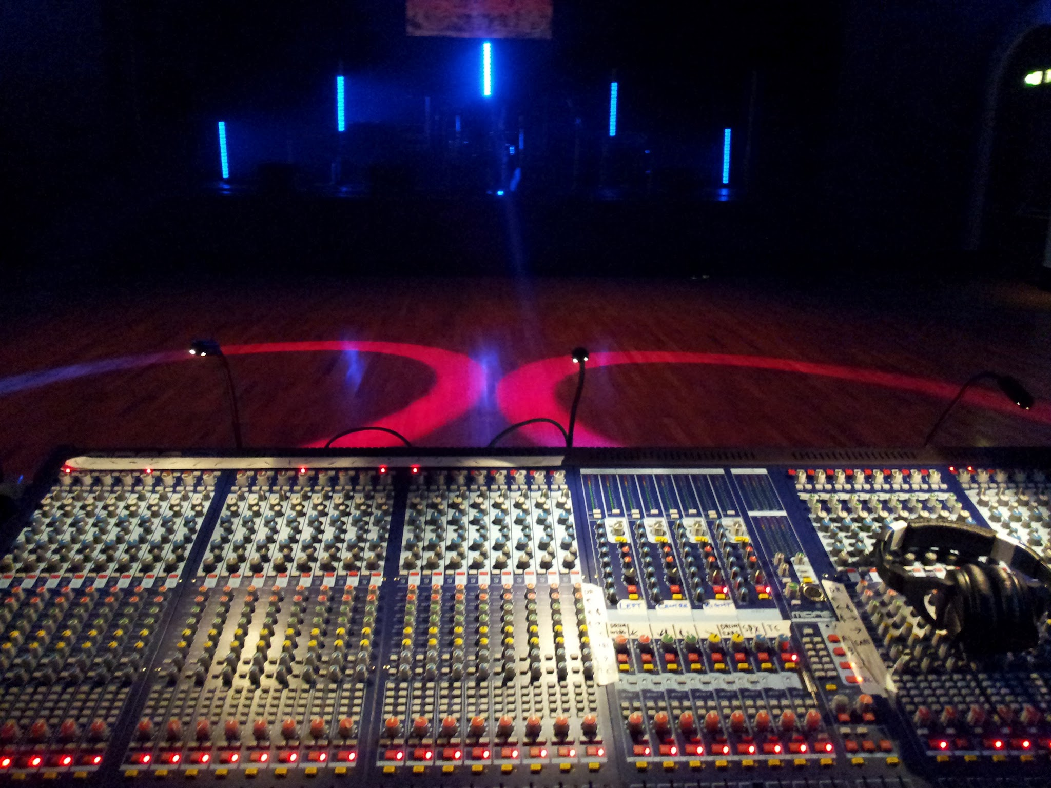 Stage and auditorium in preset lighting with te sound desk in view